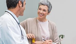 Smiling patient talking to doctor